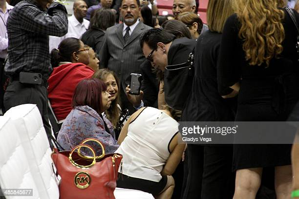 Coco Feliciano receives condolences from Salsa singer Tito Nieves at the funeral service for Cheo Feliciano at Coliseo Roberto Clemente on April 20...