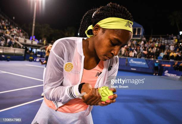 Coco Gauff autographs tennis balls after her match at the Delray Beach Open Exhibition at the Delray Beach Stadium Tennis Center on February 15 2020...