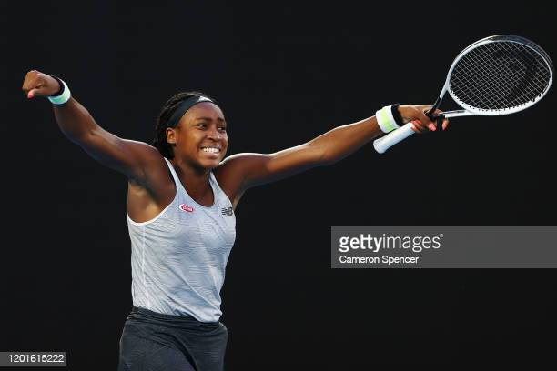Coco Gauff of the United States celebrates after winning match point during her Women's Singles third round match against Naomi Osaka of Japan day...