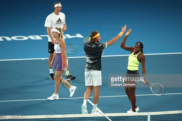 Coco Gauff of the United States high fives Stefanos Tsitsipas of Greece during the Rally for Relief Bushfire Appeal event at Rod Laver Arena on...