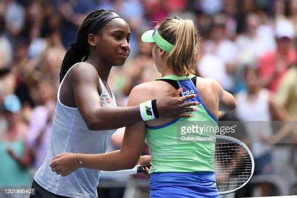 Coco Gauff of the United States hugs Sofia Kenin of the United States at the net following their Women's Singles fourth round match on day seven of...