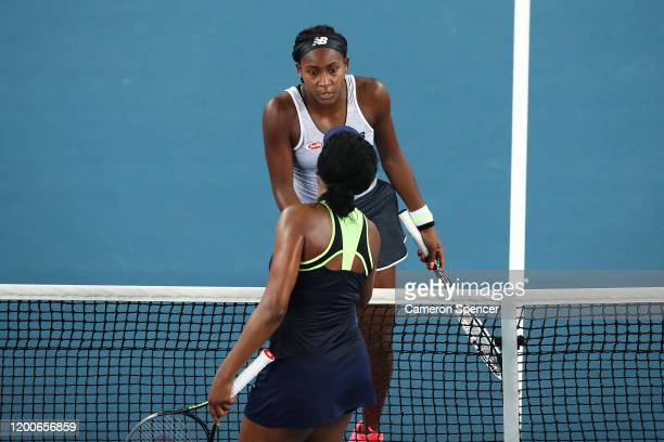 Coco Gauff of the United States of America and Venus Williams of the United States of America embrace at the net following their Women's Singles...