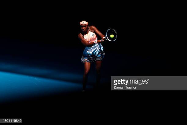 Coco Gauff of The United States of America plays a backhand in her Women's Singles first round match against Jil Teichmann of Switzerland during day...