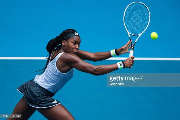 Coco Gauff of the United States plays a volley at the net in her second round match against Sorana Cirstea of Romania on day three of the 2020...