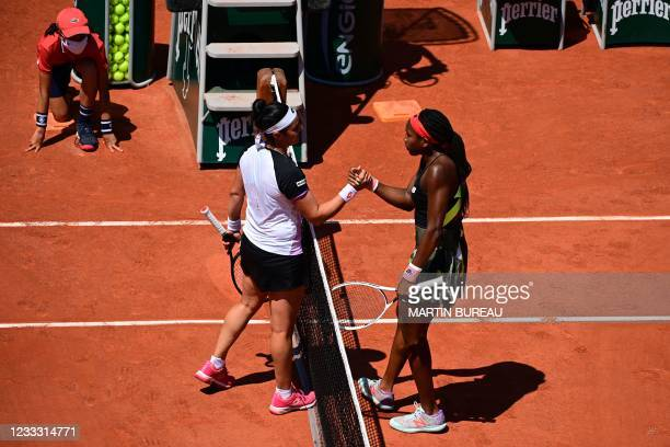 Coco Gauff of the US and Tunisia's Ons Jabeur shake hands at the end of their women's singles fourth round tennis match on Day 9 of The Roland Garros...