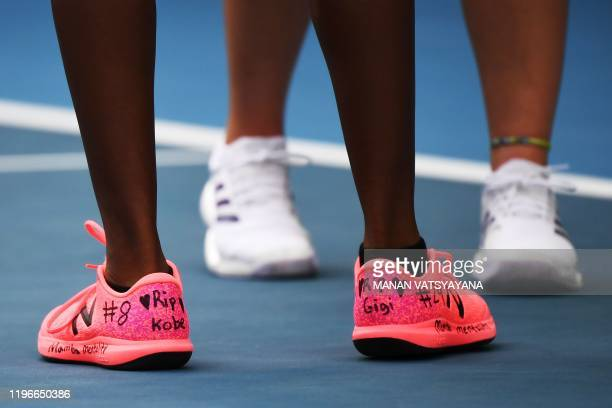 Coco Gauff of the US wearing a hand-written number on her shoe of NBA star Kobe Bryant's Los Angeles Lakers jersey play along with her teammate...