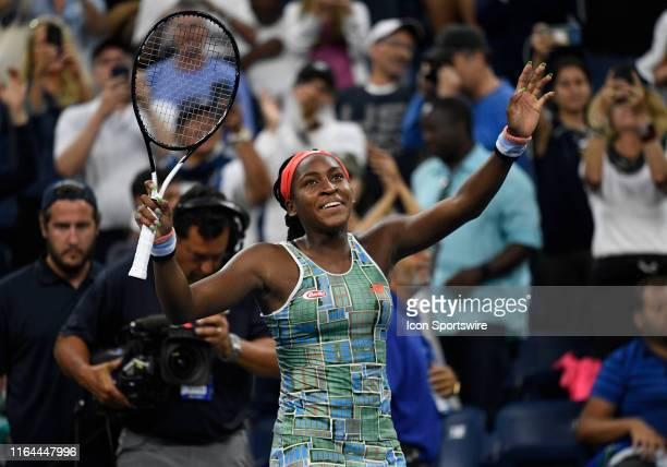 Coco Gauff raises her arms in victory after winning her first round match in the Women's Singles during a first round match at the US Open on August...