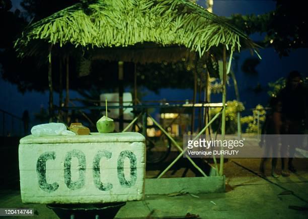 Coco juice stand in Alter De Chao village in Amazonas Brazil Caliente