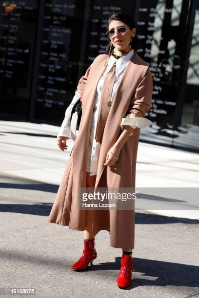 Coco Louise wearing Leo and Lin shirt dress and trench at MercedesBenz Fashion Week Resort 20 Collections on May 15 2019 in Sydney Australia