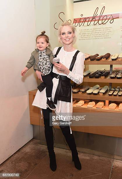 Coco Rocha and daughter Ioni James Conran attend Carebears & Sprinkles Celebrate National Hug Day at Sprinkles Cupcakes on January 21, 2017 in New...