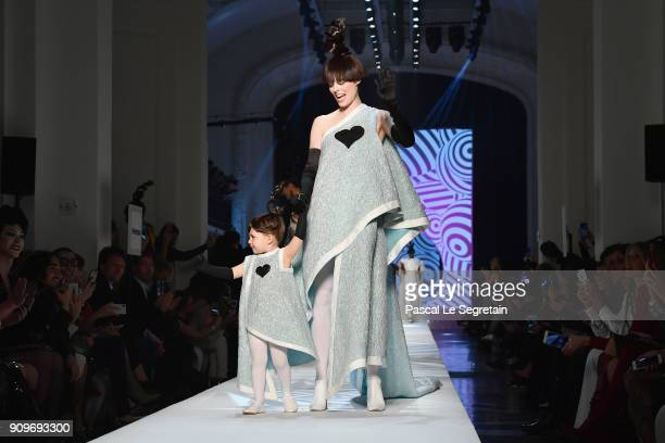 Coco Rocha and her daughter Ioni Conran walk the runway during the JeanPaul Gaultier Spring Summer 2018 show as part of Paris Fashion Week on January...