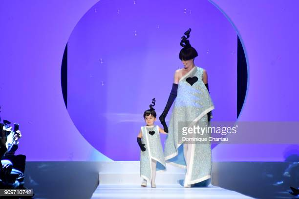 Coco Rocha and her daughter Ioni Conran walk the runway during the JeanPaul Gaultier Haute Couture Spring Summer 2018 show as part of Paris Fashion...