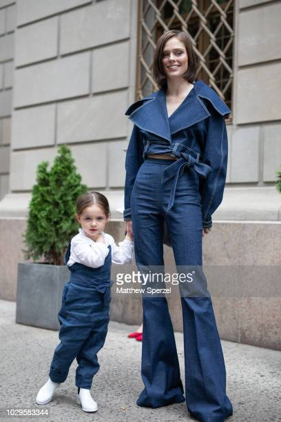Coco Rocha and her daughter Ioni James Conran are seen on the street during New York Fashion Week SS19 wearing Christian Siriano on September 8 2018...