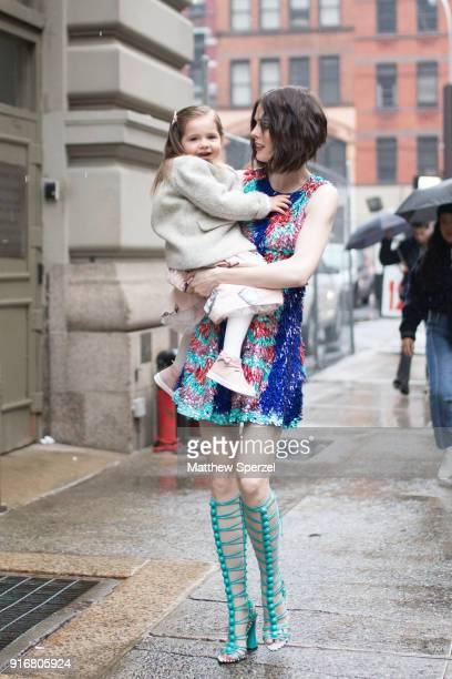 Coco Rocha and her daughter Ioni James Conran are seen on the street attending Christian Siriano during New York Fashion Week wearing Christian...