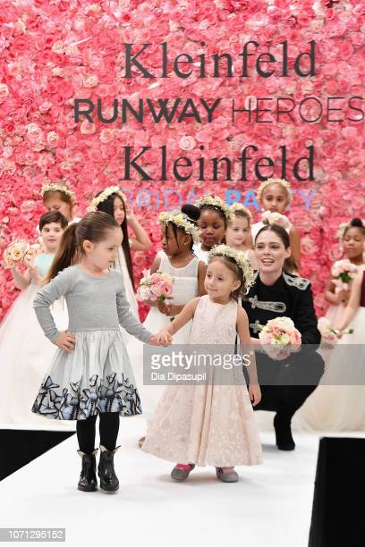 Coco Rocha and her daughter Ioni James Conran support 30 childhood cancer fighters and survivors on the runway during Runway Heroes to Benefit...