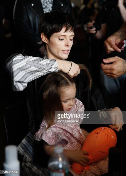 Coco Rocha and her doughter, Ioni James Conran prepare backstage during the Christian Siriano collection during the September 2017 New York Fashion...