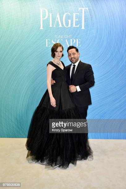 Coco Rocha and her husband pose at the Launch of Piaget sunlight escape at Palais d'Iena on June 18 2018 in Paris France