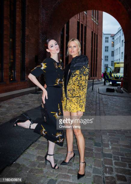 Coco Rocha and Karolina Kurkova seen during About You Fashion Week Opening Show on July 05, 2019 in Berlin, Germany.