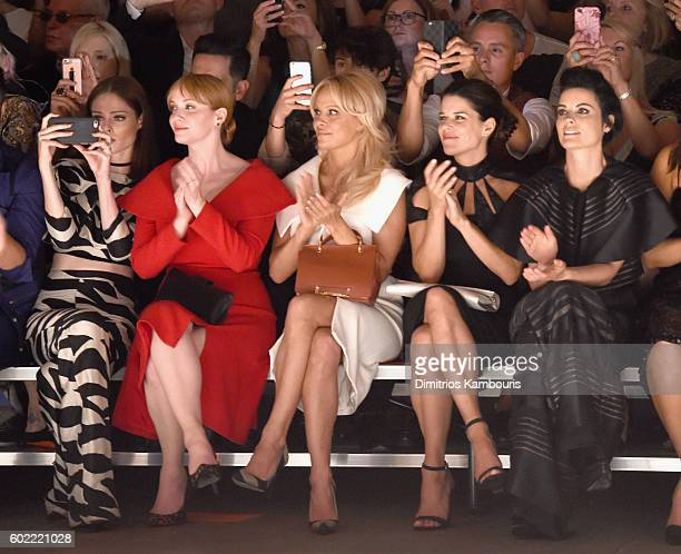 Coco Rocha Christina Hendricks Pamela Anderson Neve Campbell and Jaimie Alexander attend the Christian Siriano fashion show during New York Fashion...