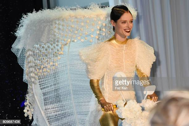 Coco Rocha drives a tricycle on the runway during the Jean Paul Gaultier Haute Couture Fall/Winter 2017-2018 show as part of Haute Couture Paris...