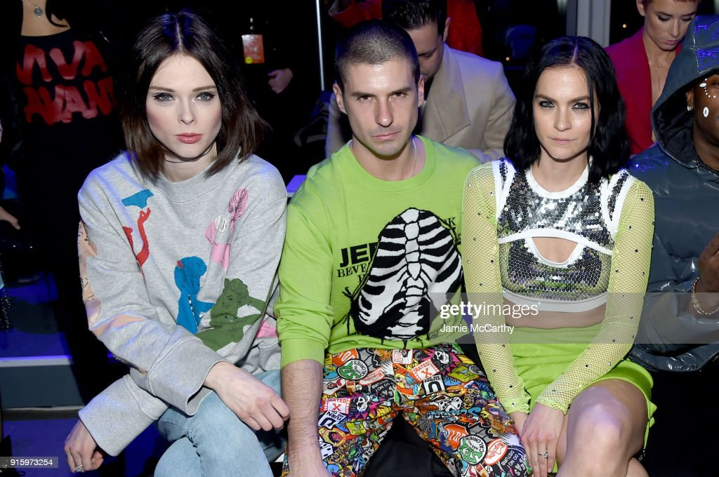 Coco Rocha, Geordon Nicol, and Leigh Lezark attend the Jeremy Scott front row during New York Fashion Week: The Shows at Gallery I at Spring Studios on February 8, 2018 in New York City.