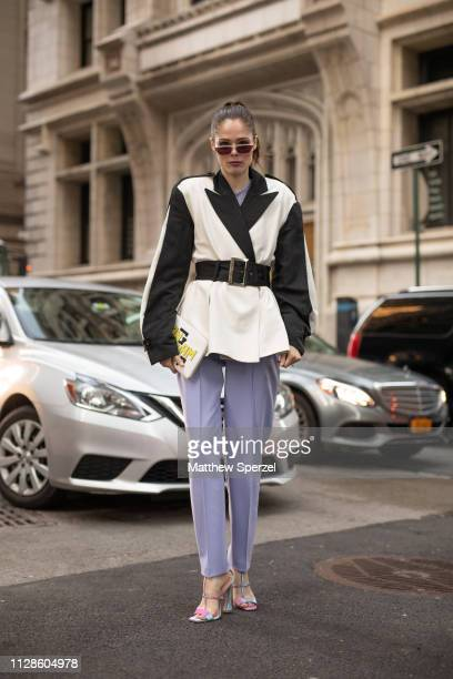 Coco Rocha is seen on the street during New York Fashion Week AW19 wearing Longchamp with pastel purple pants on February 09 2019 in New York City