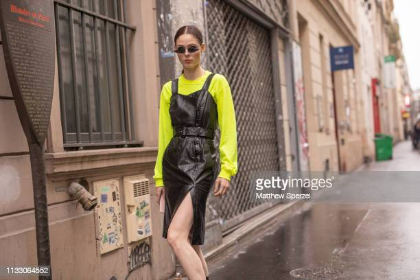 Coco Rocha is seen on the street during Paris Fashion Week AW19 wearing OLIVIER THEYSKENS, neon long sleeve shirt and black boots on March 01, 2019...