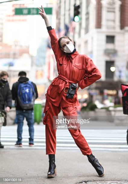 Coco Rocha is seen wearing a red outfit and Tod's purse outside the Christian Siriano show during New York Fashion Week F/W21 on February 25, 2021 in...