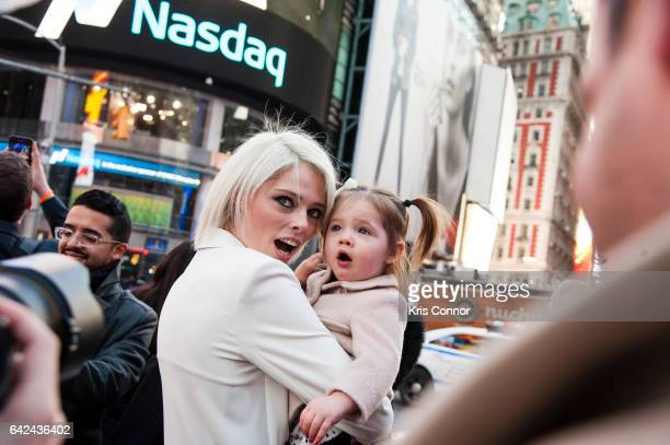 Coco Rocha poses for a photo with daughter Ioni James Conran after ringing in the closing bell at NASDAQ on February 17, 2017 in New York City.