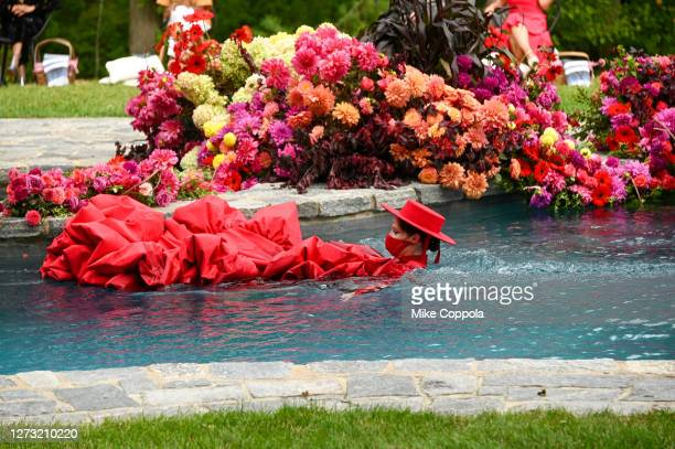 Coco Rocha swims in the pool at the runway for the Christian Siriano Collection 37 2020 Fashion Show on September 17, 2020 in Westport, Connecticut.