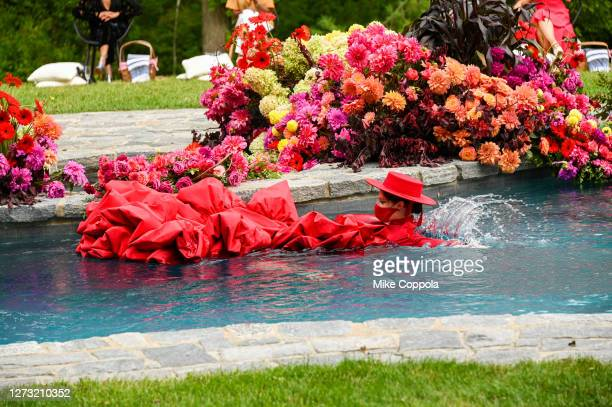 Coco Rocha swims in the pool at the runway for the Christian Siriano Collection 37 2020 Fashion Show on September 17 2020 in Westport Connecticut