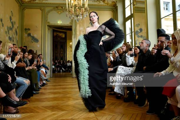 Coco Rocha walks the runway during the Christian Siriano Womenswear Spring/Summer 2020 show as part of Paris Fashion Week on September 25, 2019 in...