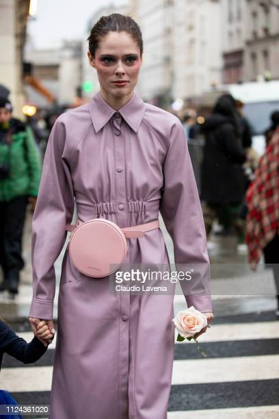 Coco Rocha, wearing a lilac leather dress and pink fanny pack, is seen outside Jean Paul Gaultier show during Paris Fashion Week - Haute Couture...