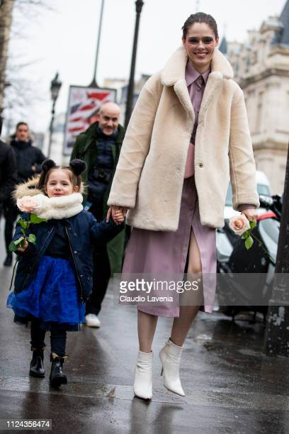 Coco Rocha wearing a lilac leather dress cream fur jacket white boots and pink fanny pack is seen outside Jean Paul Gaultier show during Paris...