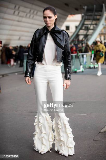 Coco Rocha wearing a white top white decorated pants and black leather pants is seen outside Giambattista Valli on Day 8 Paris Fashion Week...