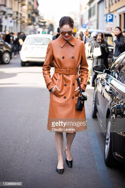 Coco Rocha, wearing an orange leather coat, black Tod's bag and black heels, is seen outside Tod's show, during Milan Fashion Week Fall/Winter...