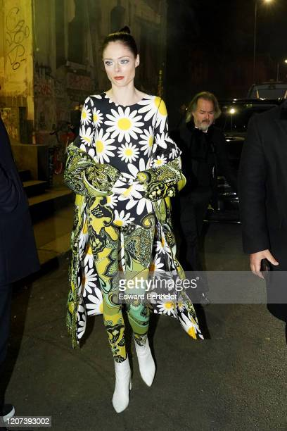 Coco Rocha wears a floral print bodysuit leggings white shoes a coat outside Moncler during Milan Fashion Week Fall/Winter 20202021 on February 19...