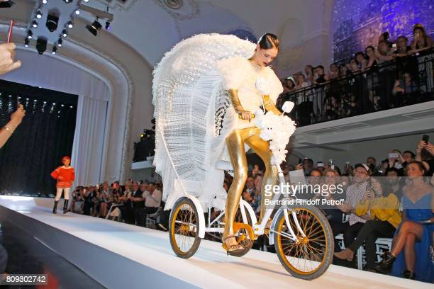 Coco Rocha wolks the runway in front of Catherine Deneuve, Loic Prigent, Aloise Sauvage and Fauve Hautot during the Jean Paul Gaultier Haute Couture...
