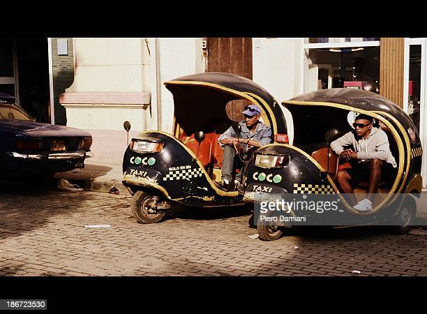 CONTENT] Coco Taxi drivers waiting for customers in Havana Cuba