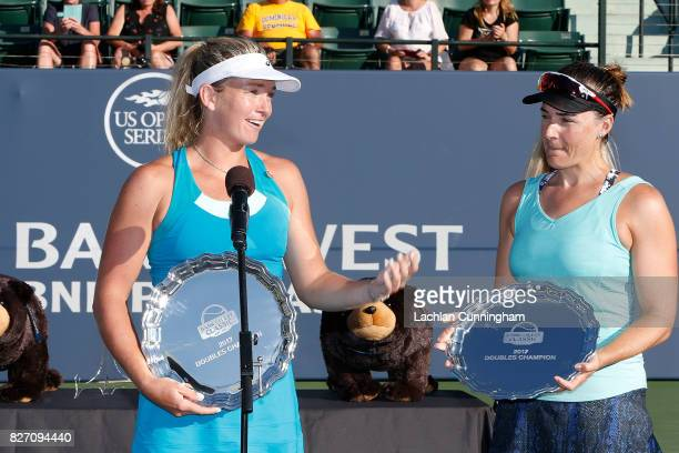 CoCo Vandeweghe and Abigail Spears of the United States address the crowd with their trophies after winning the doubles final against Alize Cornet of...