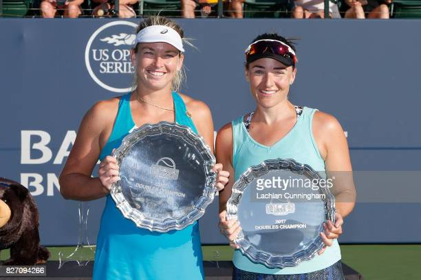 CoCo Vandeweghe and Abigail Spears of the United States pose with their trophies after winning the doubles final against Alize Cornet of France and...