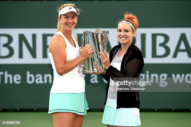CoCo Vandeweghe and Bethanie Mattek-Sands pose with the winner's tropy after defeating Julia Goerges of Germany and Karolina Pliskova of Czech...