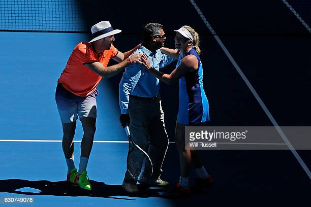 Coco Vandeweghe and Jack Sock of the United States congratulate one of the line refs after being invited to play during the mixed doubles match...