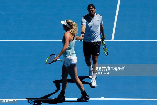 Coco Vandeweghe and Jack Sock of the United States in the mixed doubles match against Karen Khachanov and Anastasia Pavlyuchenkova of Russia on day...