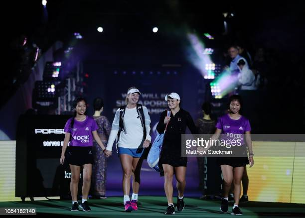 CoCo Vandeweghe of the United States and Ashleigh Barty of Australia walk onto the court before playing Timea Babos of Hungary and Kristina...