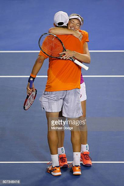 Coco Vandeweghe of the United States and Horia Tecau of Romania celebrate after winning their mixed doubles semi final match against Andreja Klepac...