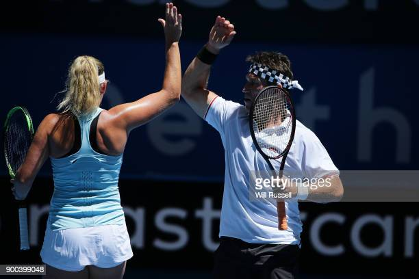 Coco Vandeweghe of the United States and Tennis legend Pat Cash filling in for an injured Jack Sock of the United States in in the mixed doubles...