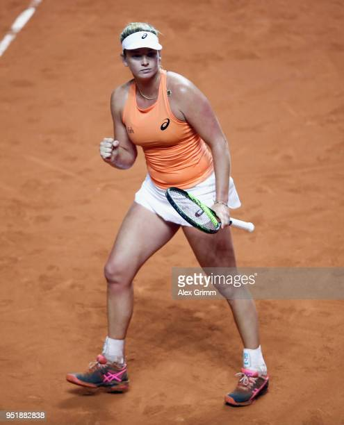 CoCo Vandeweghe of the United States celebrates after defeating Simona Halep of Romania during day 5 of the Porsche Tennis Grand Prix at PorscheArena...
