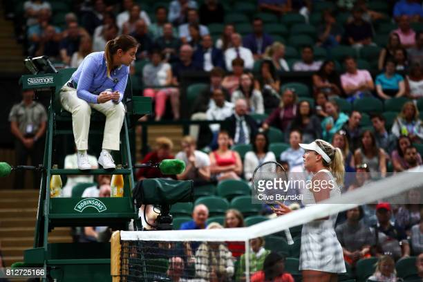 Coco Vandeweghe of The United States in discussion with the chair umpire during the Ladies Singles quarter final match against Magdalena Rybarikova...