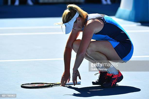 Coco Vandeweghe of the United States reacts to the heat in her first round match against Roberta Vinci of Italy on day one of the 2017 Australian...